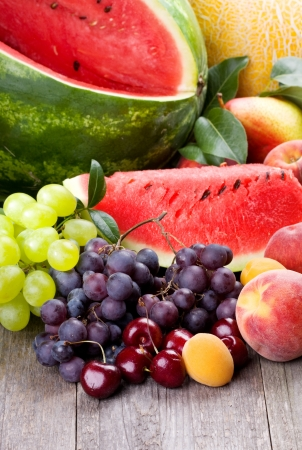 fresh fruits and berries on wooden table