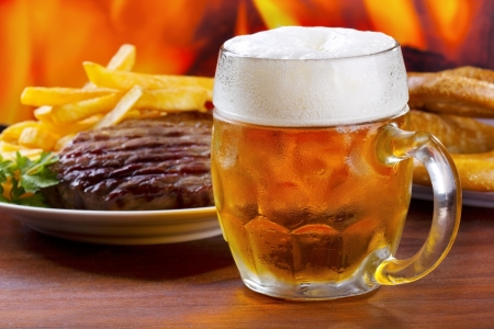 mug of beer with grilled meat