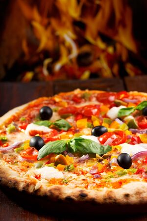 pizza with vegetables and green basil Stock Photo - 15639046