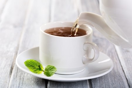 Pouring tea into cup of tea Stock Photo - 15629274