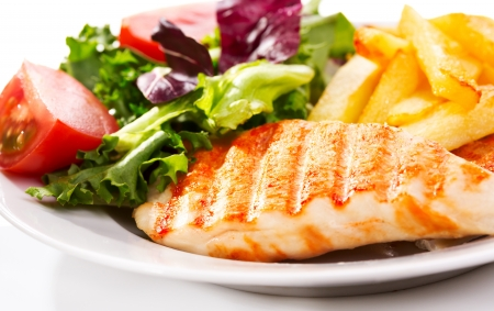 Grilled chicken breast with fries and salad Stock Photo - 15629282