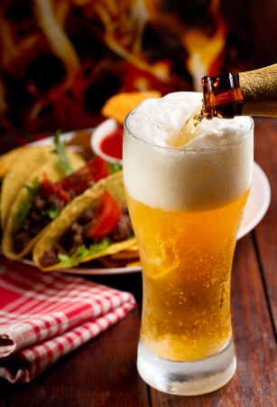 taco: Beer pouring into glass  Stock Photo