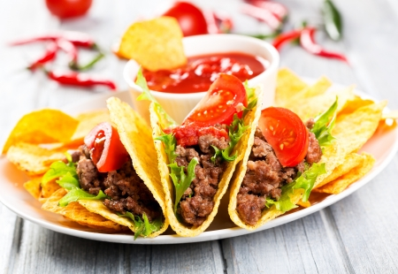plate with taco, nachos chips and tomato dip photo
