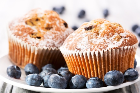 blueberry muffin: muffins with fresh blueberries on wooden table