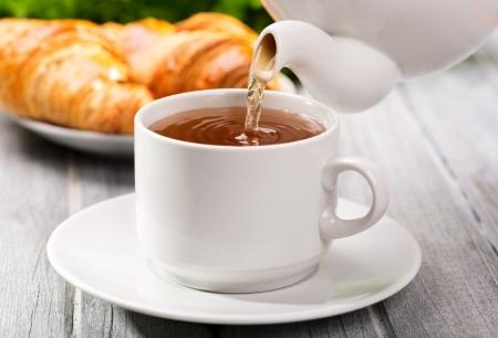 white tea: Pouring tea into cup of tea
