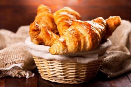 fresh croissants on wooden table  Stock Photo