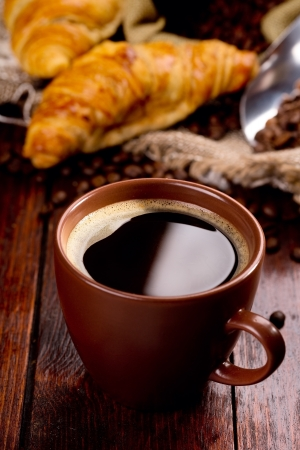 cup of black coffee and croissants Stock Photo - 15774529