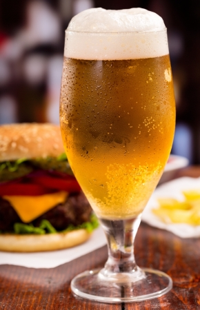 condensation: glass of beer and hamburger