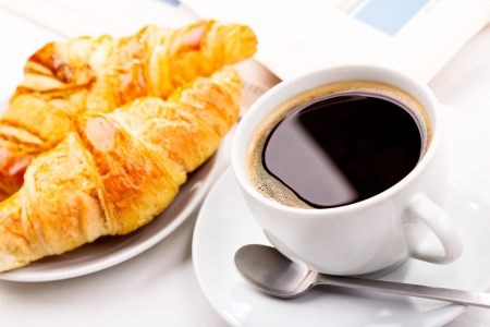 breakfast with cup of black coffee, croissants and newspaper Stock Photo - 16409452