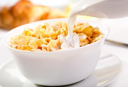 corn flakes: milk pouring into corn flakes
