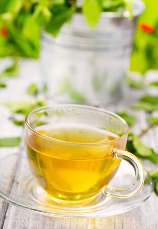 cup of tea on wooden table Stock Photo - 16409438