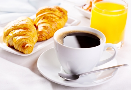 croissant: breakfast with cup of coffee, croissants and orange juice