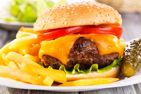 hamburger with fries on wooden table Stock Photo