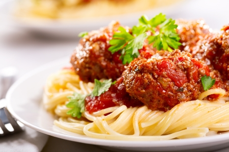 spaghetti dinner: pasta with meatballs and parsley with tomato sauce