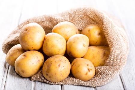raw potato:  fresh potatoes on wooden table Stock Photo
