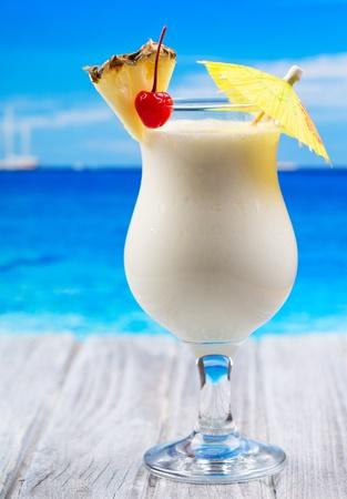 pina: tropical cocktail on a beach
