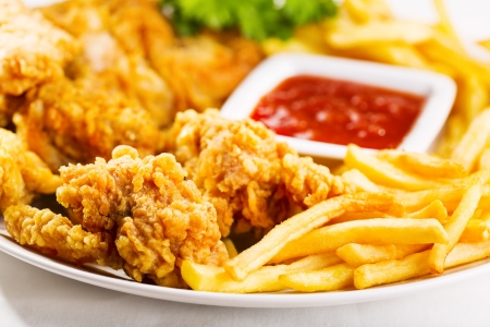 fried chicken with fries on a plate