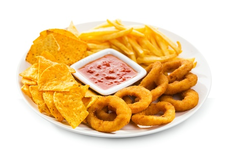 onion rings, fries and nachos on a white background photo