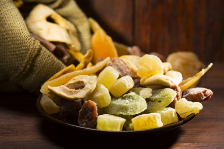 mix of dried fruits on wooden table photo