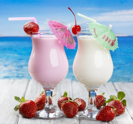 tropical cocktails with fresh berries on a beach photo