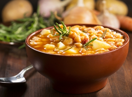 potato soup: bowl of bean soup with rosemary Stock Photo
