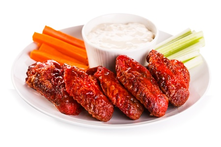 Fried Chicken Wings with vegetables on white background photo