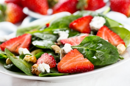 salad greens: salad with strawberry, spinach leaves and feta cheese