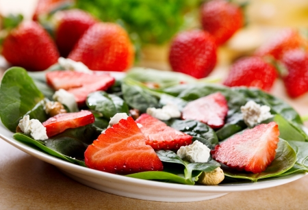 spinach salad: salad with strawberry, spinach leaves and feta cheese