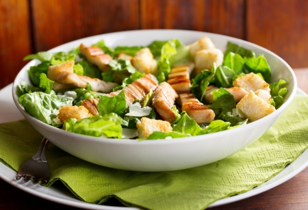 caesar salad:  chicken salad on a plate Stock Photo