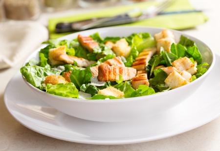 CHICKEN CAESAR SALAD: chicken salad on a plate