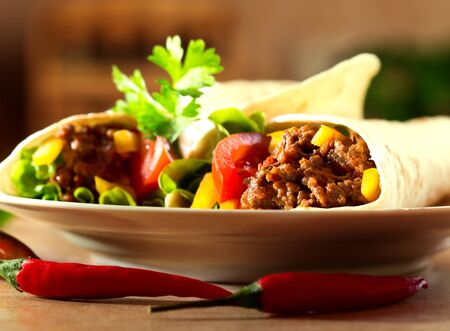 fresh tortilla wraps with meat and vegetables photo