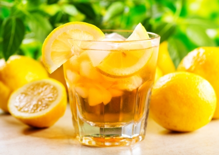 ice lemon tea: glass of ice tea with lemon  Stock Photo