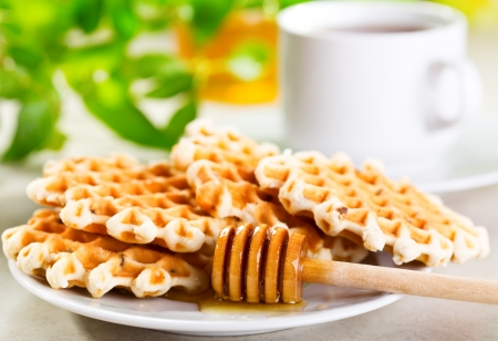 waffles with honey and cup of tea photo