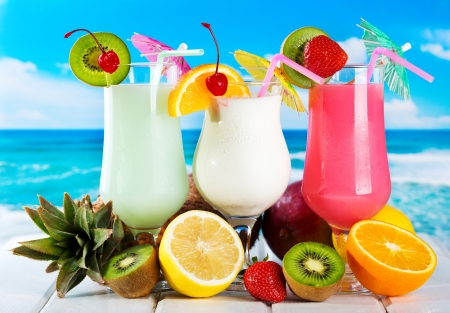 fruits cocktails on a beach photo