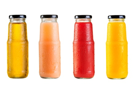 fruit juices: different bottles of juice on white background