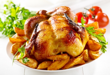 whole roasted chicken with vegetables Stock Photo