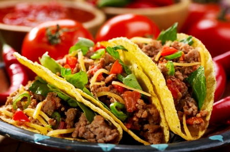 plate of tacos on wooden table Stock Photo