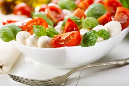 caprese salad: salad with mozzarella, tomatoes and green basil