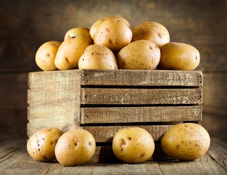 raw potato: fresh potatoes in wooden box