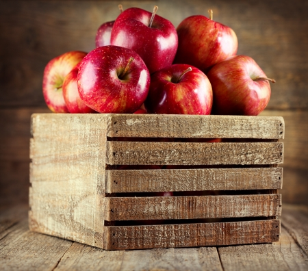 wooden box: fresh red apples in wooden box