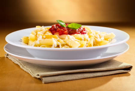 penne: plate of penne pasta with tomato sauce