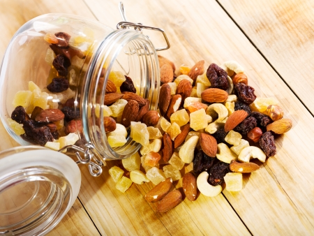 energy mix: mixed nuts and dried fruits on wooden table