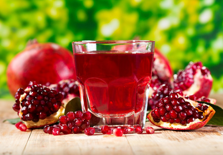 glass of pomegranate  juice with fresh fruits on wooden table Stok Fotoğraf - 26015651
