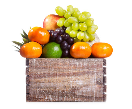 fresh fruits in a box on white background photo