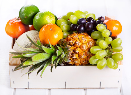 fresh fruits in a box on wooden table photo