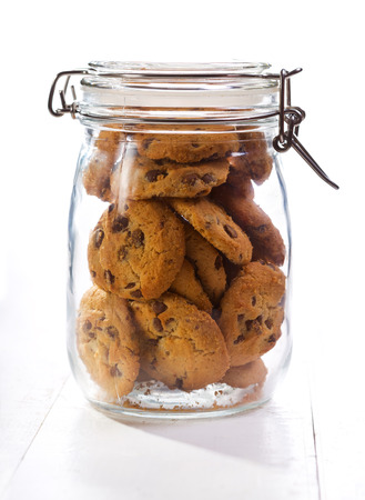 glass cookie jar chocolate cookies in a glass jar on wooden table
