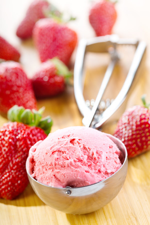 frozen fruit: strawberry ice cream with fresh berries