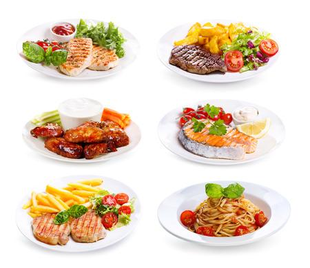 platen van diverse vlees, vis en kip op een witte achtergrond Stockfoto
