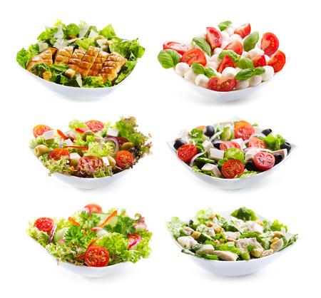 ensalada cesar: conjunto de ensaladas Varioust sobre fondo blanco Foto de archivo