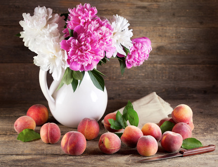 Peach flower: Still life with bouquet of peonies and peaches